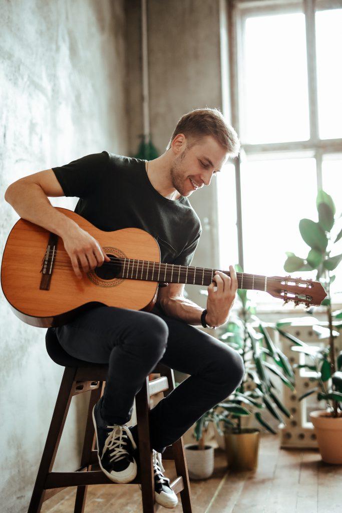 Guitarist Performing For Senior Citizens
